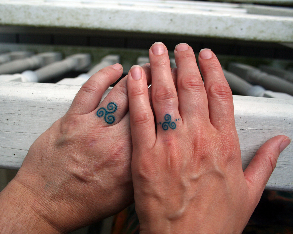 White ink wedding ring tattoos