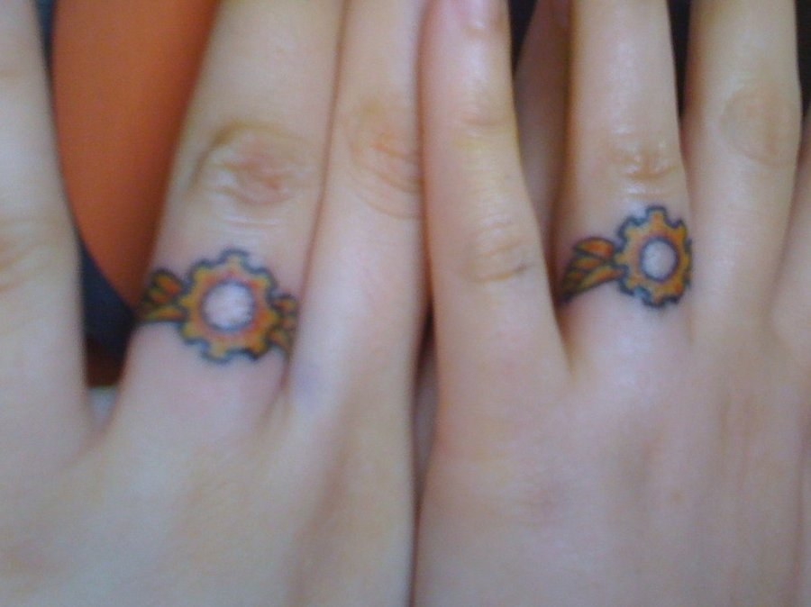 Very Best Wedding Ring Tattoos On Fingers 900 x 674 · 62 kB · jpeg
