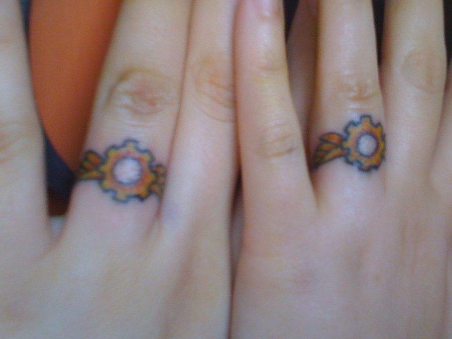Wedding Ring Tattoos Designs Gallery: 26 Beautiful Wedding Ring Tattoo Design