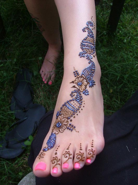 Henna foot with blue glitter