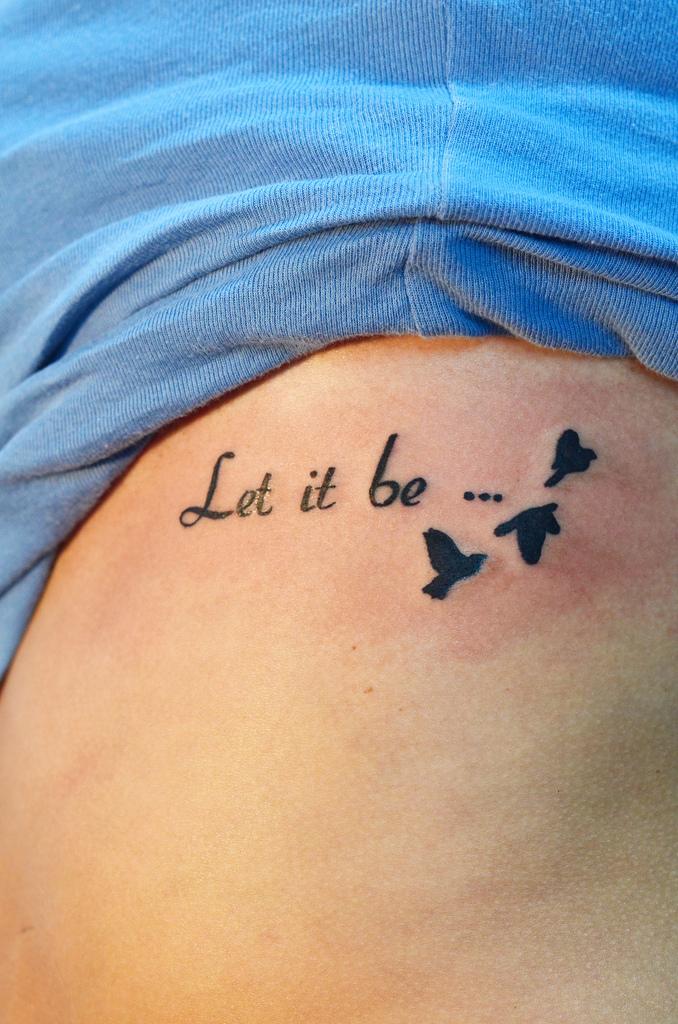 Side Ribs Tattoo