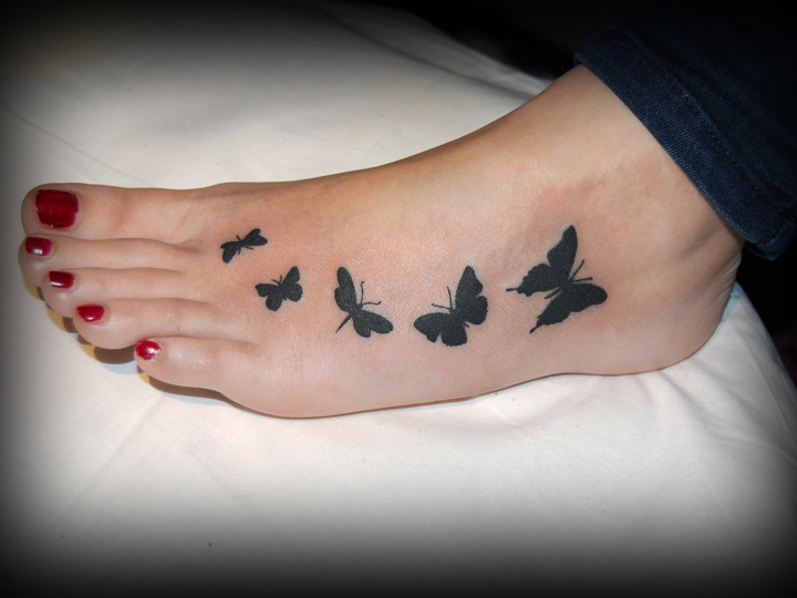 feet butterfly tattoo