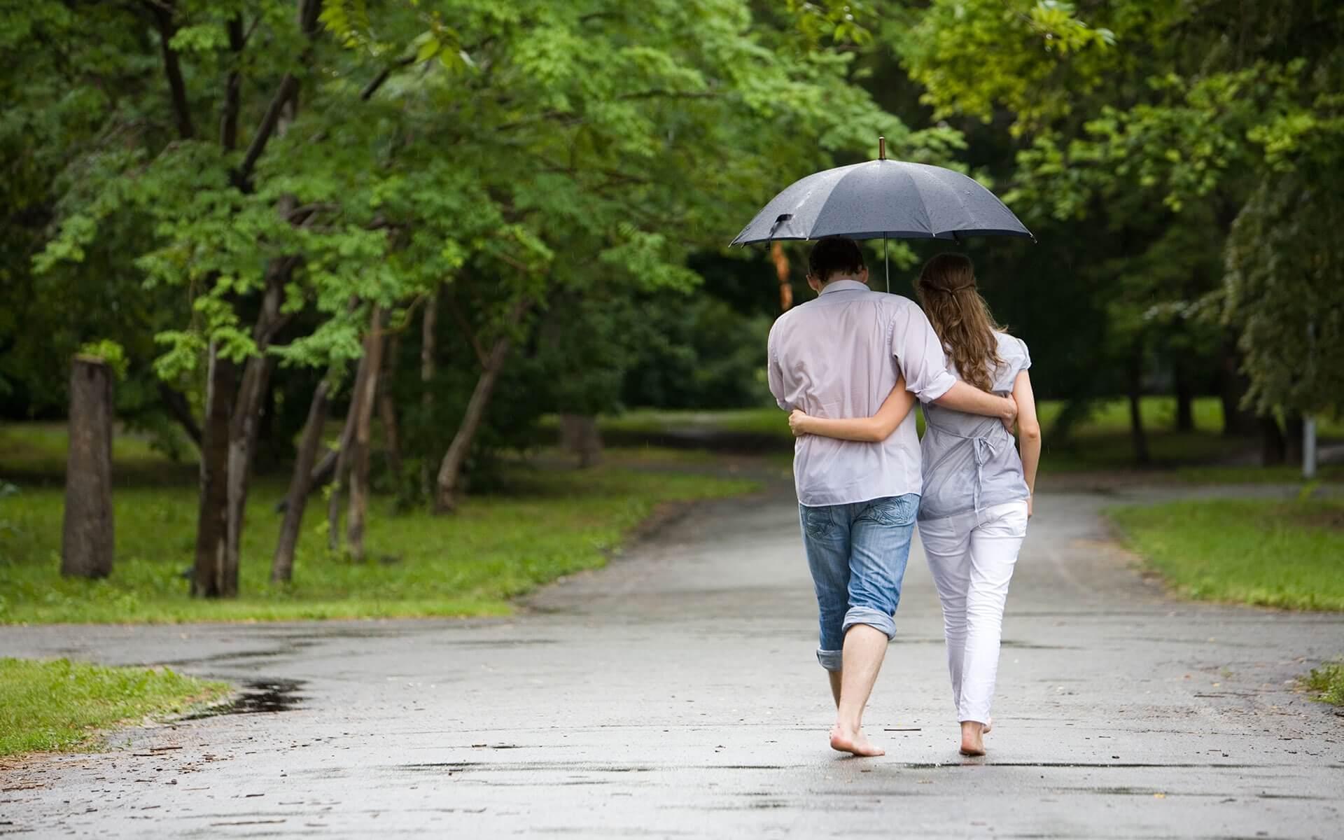 a couples walk in rain