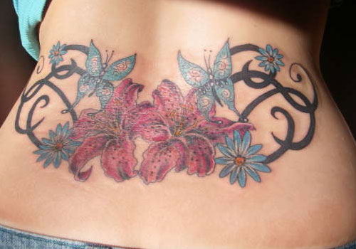 Astounding large flower tribal tattoo on lower back