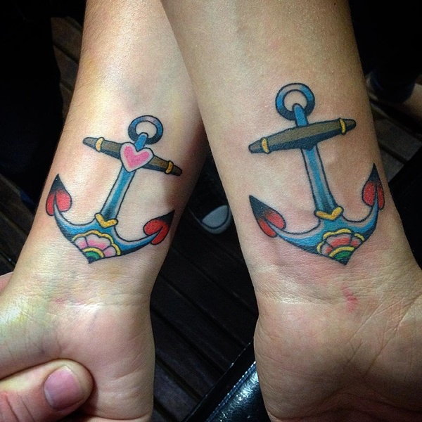colorful couples anchor tattoos on wrists