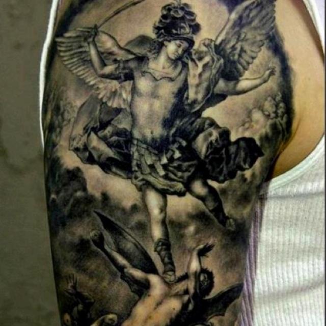 Angel and demon fighting tattoo design