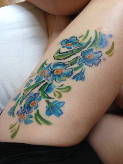 Beautiful watercolor forget me not tattoo branch