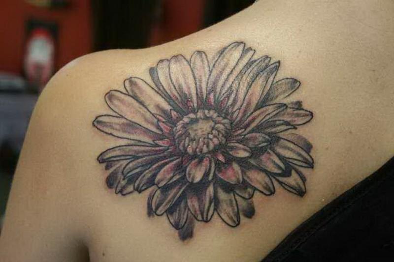 Black and white single daisy tattoo