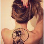 Black and white tattoo geisha on back