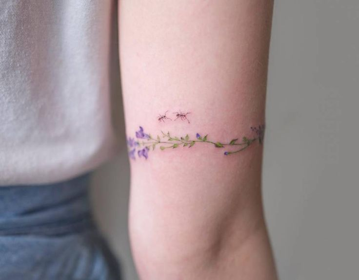 Floral watercolor band tattoo