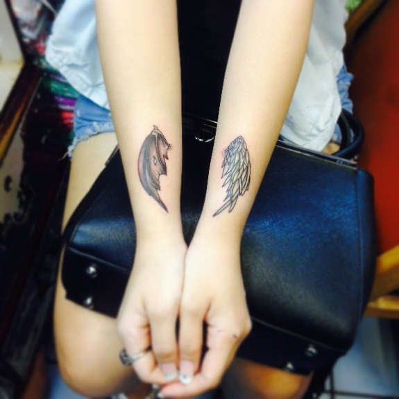 Good and evil wings on arms