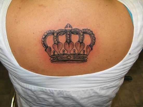 Upper back crown tattoo
