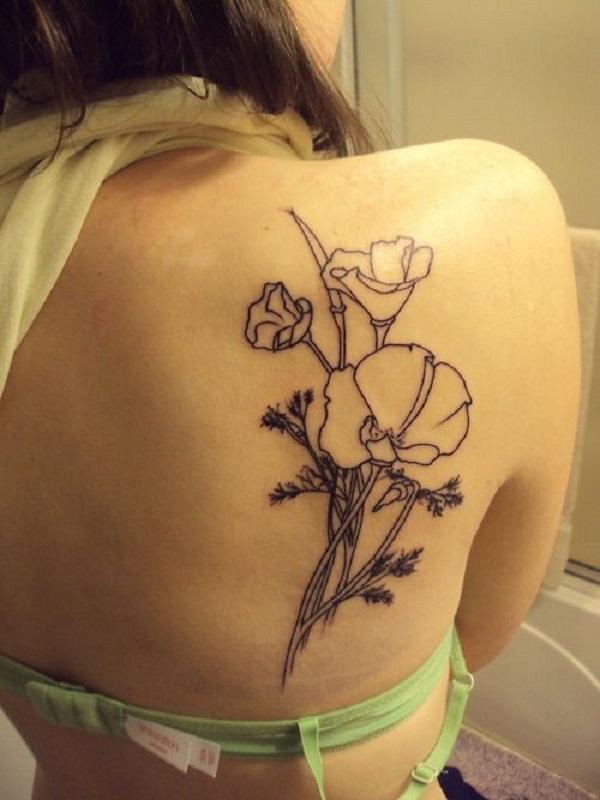 vibrant black and white poppy flower outline tattoo on back shoulder blade