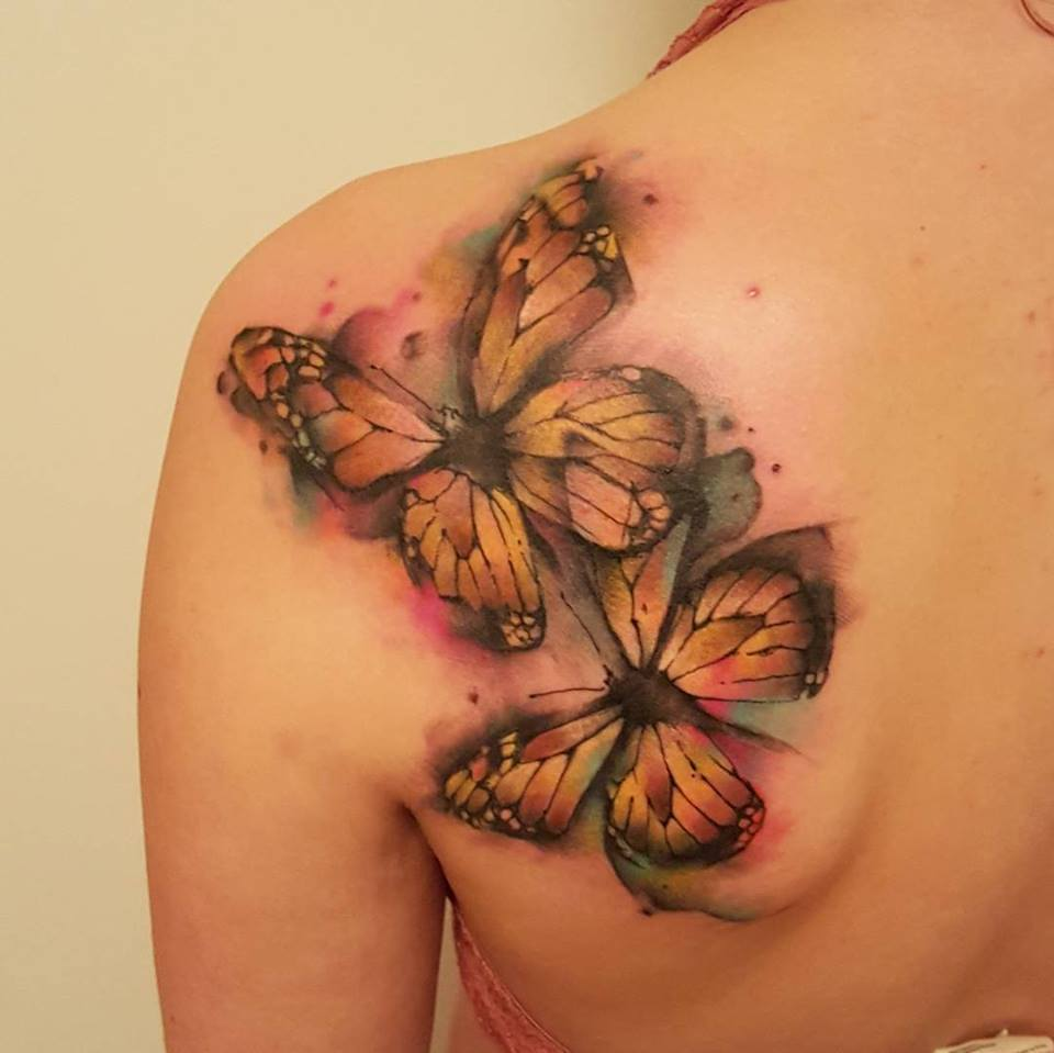 butterflies tattoo on back