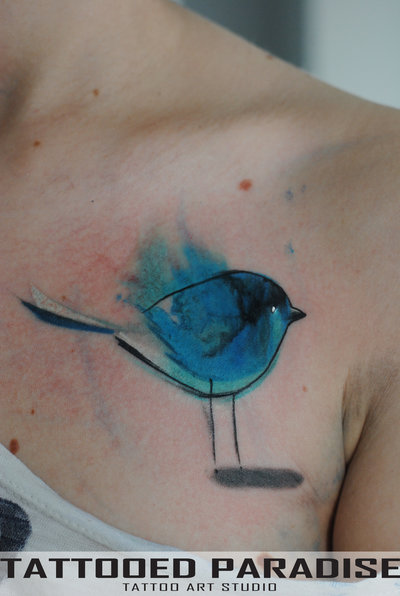 cute small watercolor tattoo on chest
