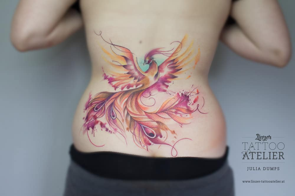 phoenix watercolor tattoo on back