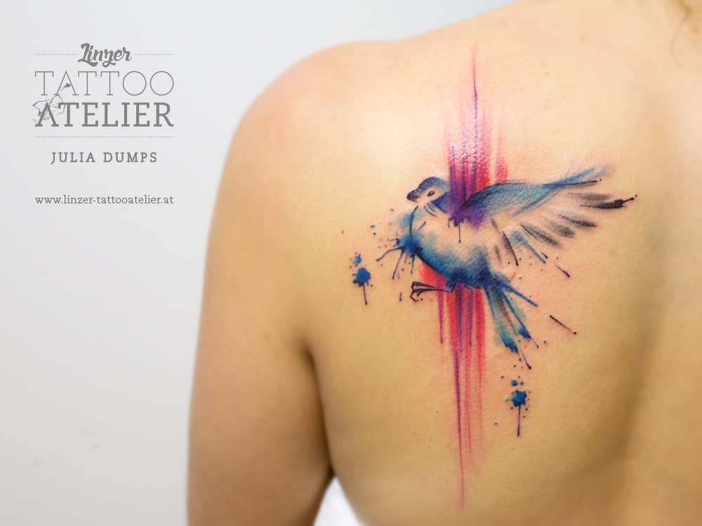watercolor bird tattoo on back