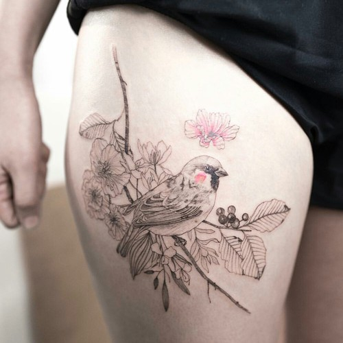 watercolor inked bird and flowers tattoo on thigh