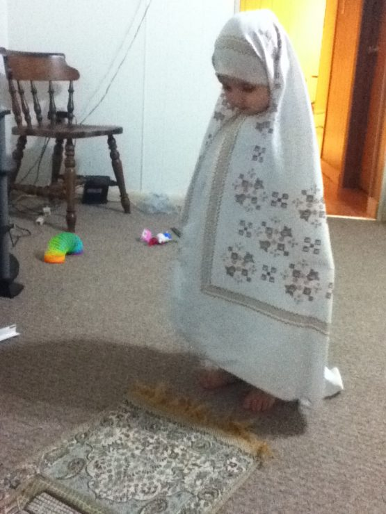 little girl in scarf praying namaz