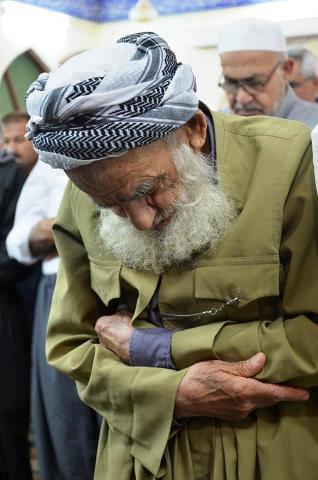 old man praying namaz