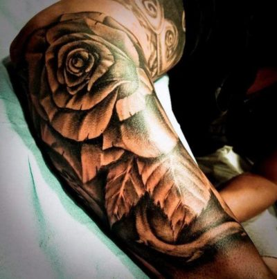 black and white rose tattoo on sleeves