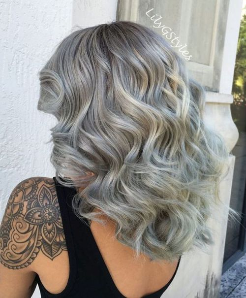 mid-length thick curly gray hairstyle