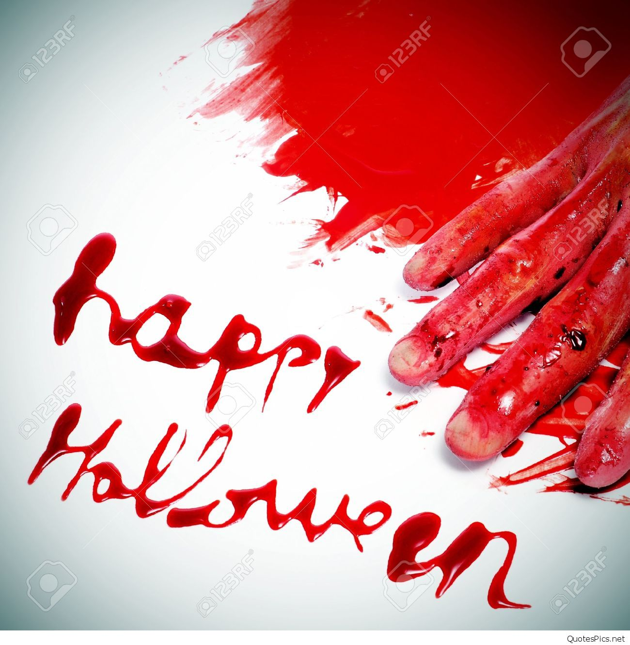 Happy-Halloween-written-with-blood-and-a-scary-and-bloody-hand-in-a-pool-of-blood-Stock-Photo