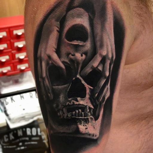 3d hand skull face tattoo