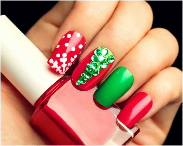 Glamorous Christmas Nail art manicure with green gems and snowflakes