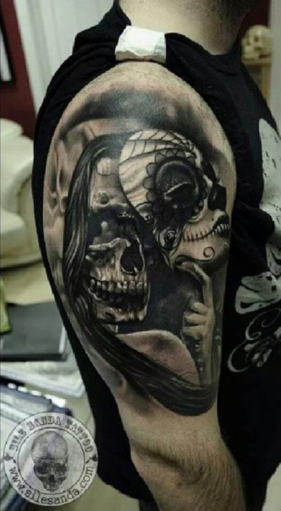Skull mask sleeve tattoo