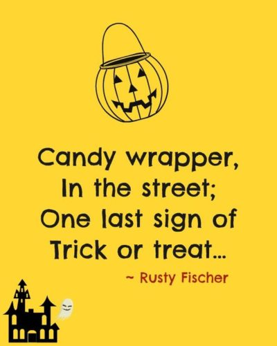 candy wrapper in the street; one last sign of trick or treat