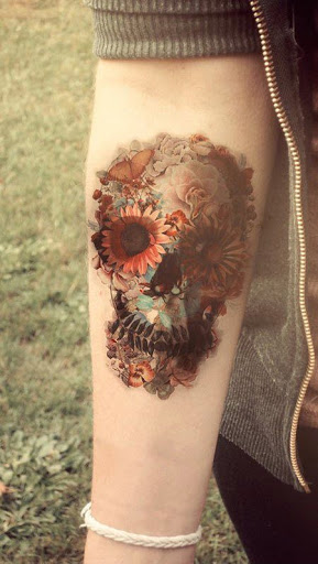 classic floral skull forearm tattoo