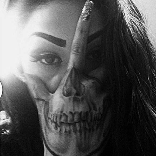 creative skull tattoo on hand