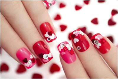 red and pink heart shaped sequins nail art