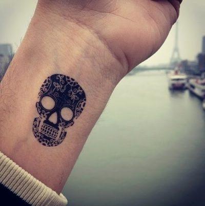 small sugar skull wrist tattoo design