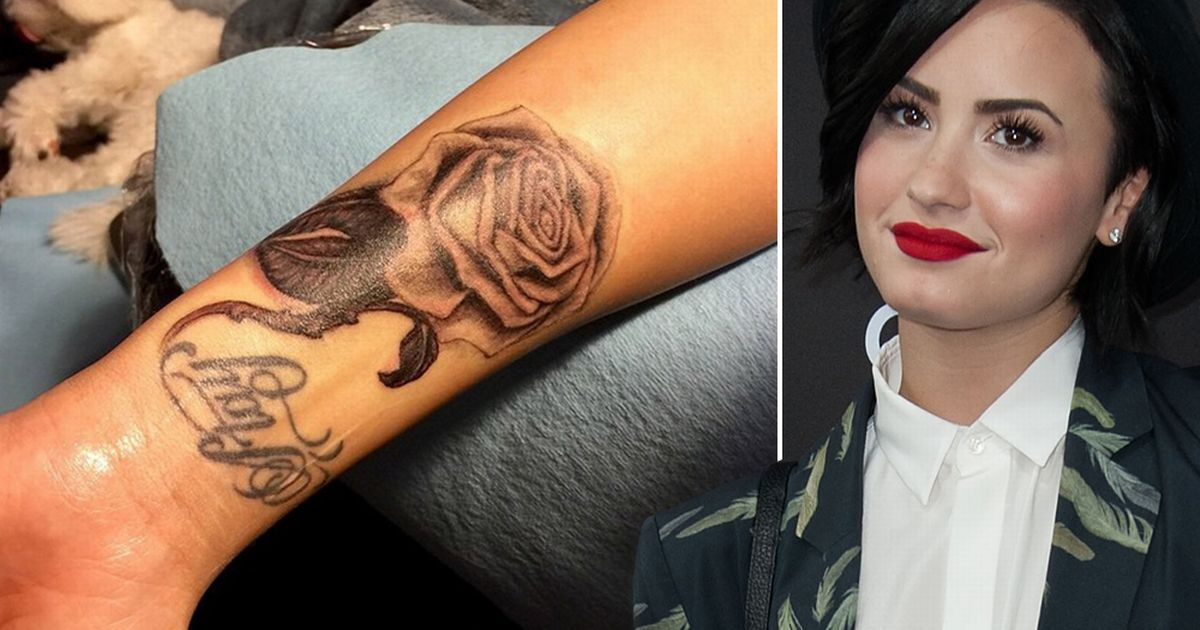 Demi Lovato black and grey Rose tattoo