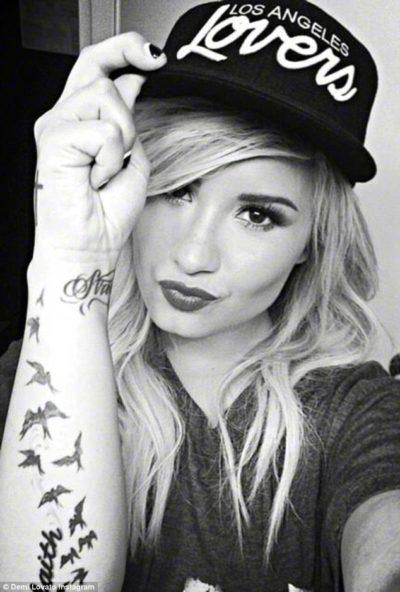 Demi Lovato flock of birds tattoo