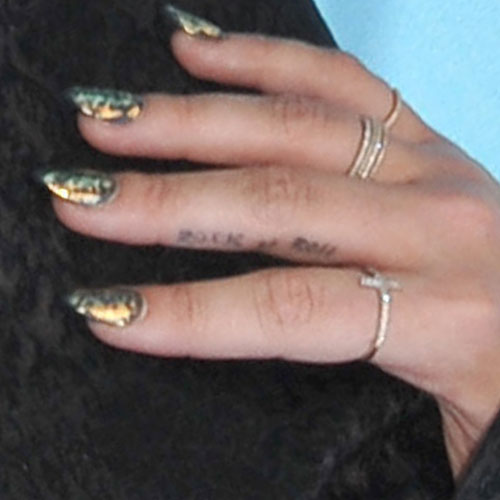 Demi Lovato middle finger tattoo