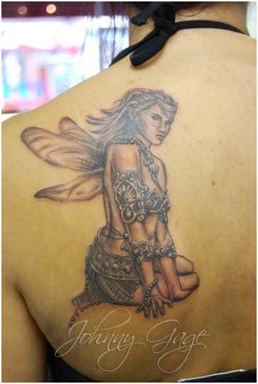 angel and rosary tattoo on back