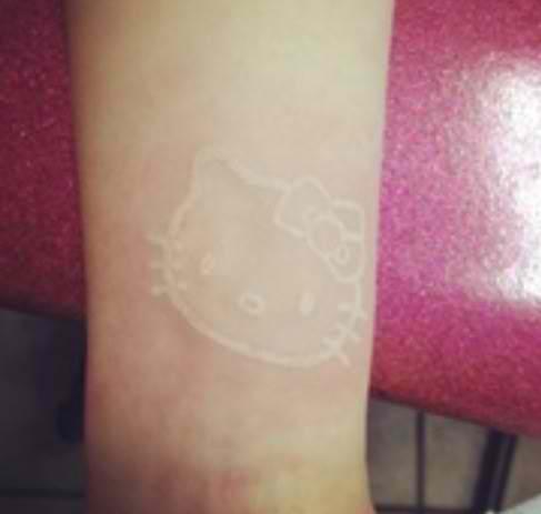 hello kitty white ink tattoo