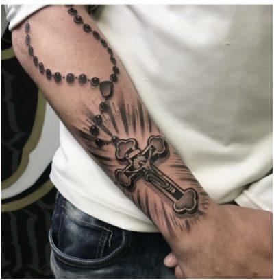 rosary tattoo design on forearm