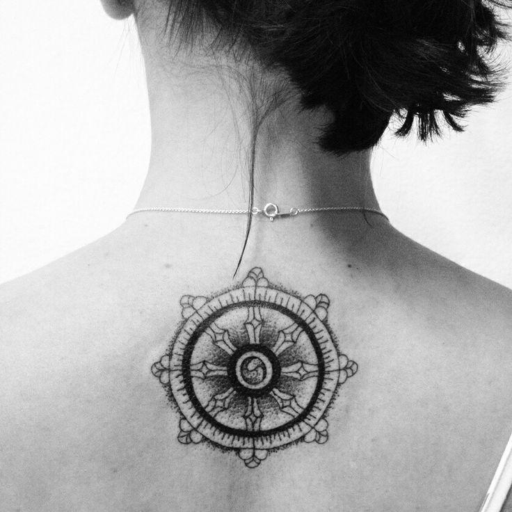 dharma wheel tattoo on back neck