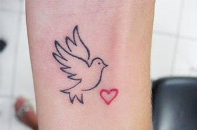 small simple outline red heart and dove tattoo on wrist