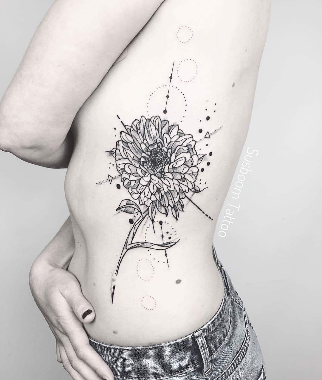 Geometrical Aster Flower Tattoo With Minimal Ink