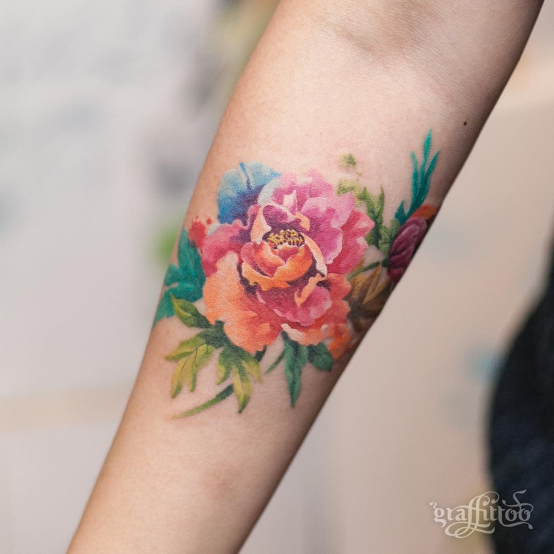 colorful peony flower Tattoo on forearm