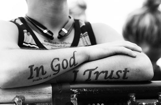 in god we trust tattoo on arms