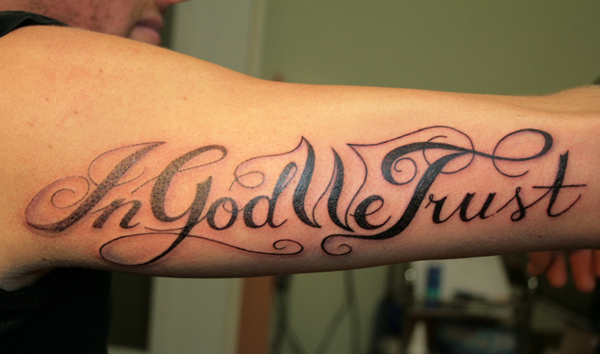 in god we trust tattoo on sleeve
