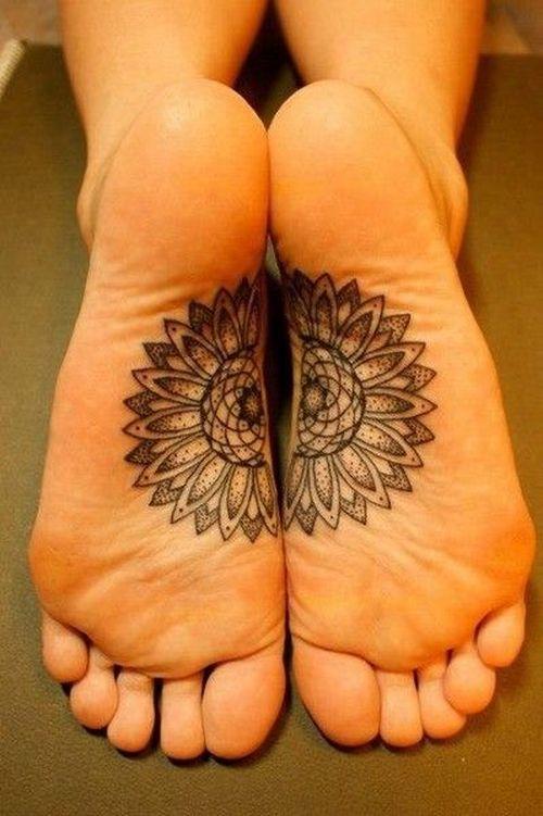 tribal lotus tattoo on both feet
