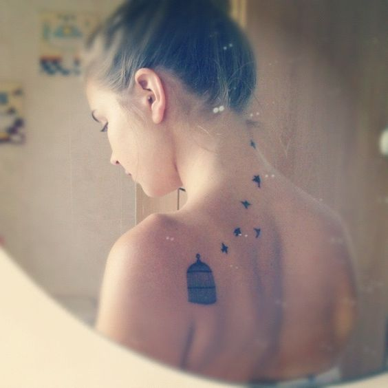 freedom tattoo bird cage tattoo on back for women