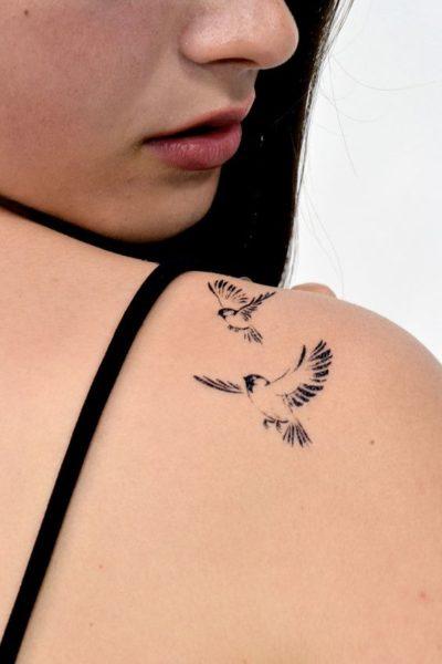 subtle birds print tattoo on shoulder for women